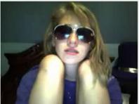 Webcam teen in black glasses