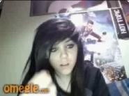 Emo girl plays with hairbrush